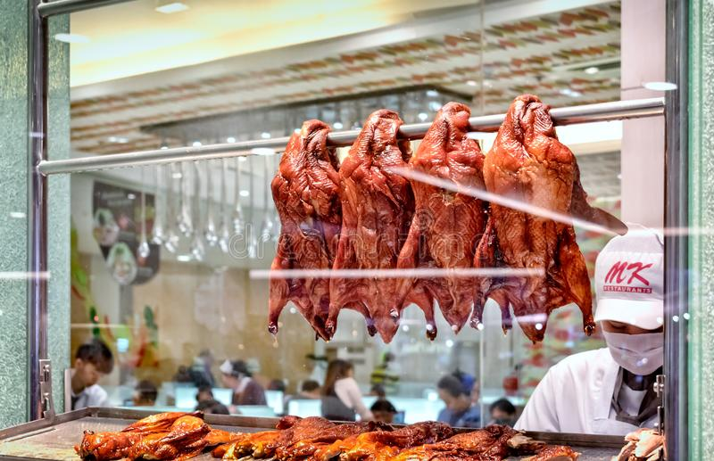 BANGKOK, THAILAND - DECEMBER 17: MK Restaurant in Seacon Square. Shopping mall shows preparation of peking duck through a glass display on December 17, 2017 in stock photo