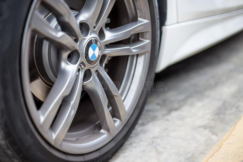 Selective focus of BMW brand wheels on the parking lot background royalty free stock image