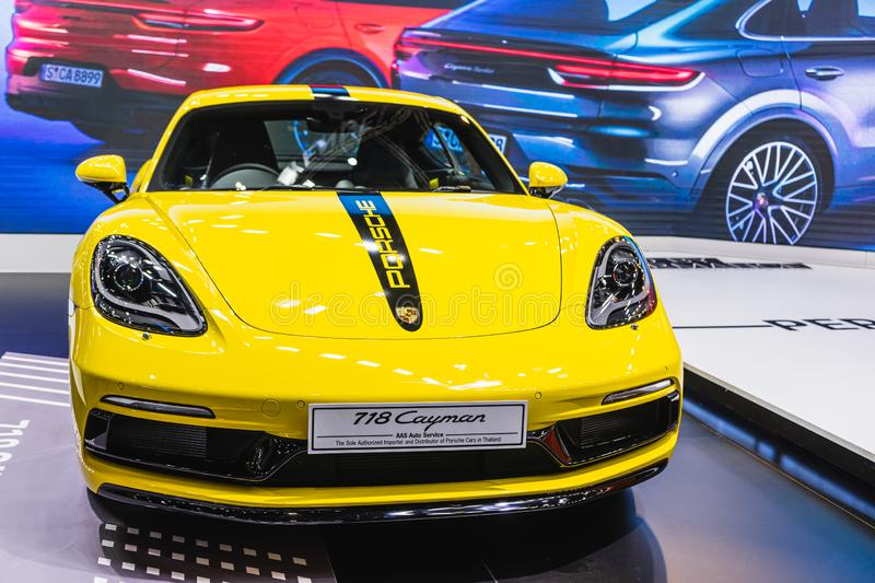 Bangkok, Thailand - Decemebr 3, 2019 : Yellow Porsche 718 Cayman sports car display on the Bangkok Motor Expo 2019 in Thailand stock photography