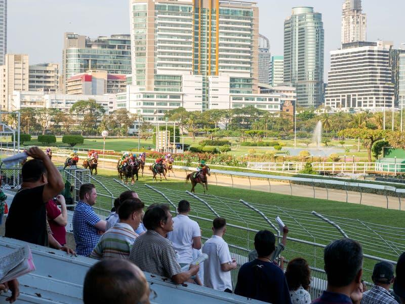 Bangkok, Thailand - Feb 24, 2019: Group of horses charging for the finish line during racing day at The Royal Bangkok Sports Club.  royalty free stock images
