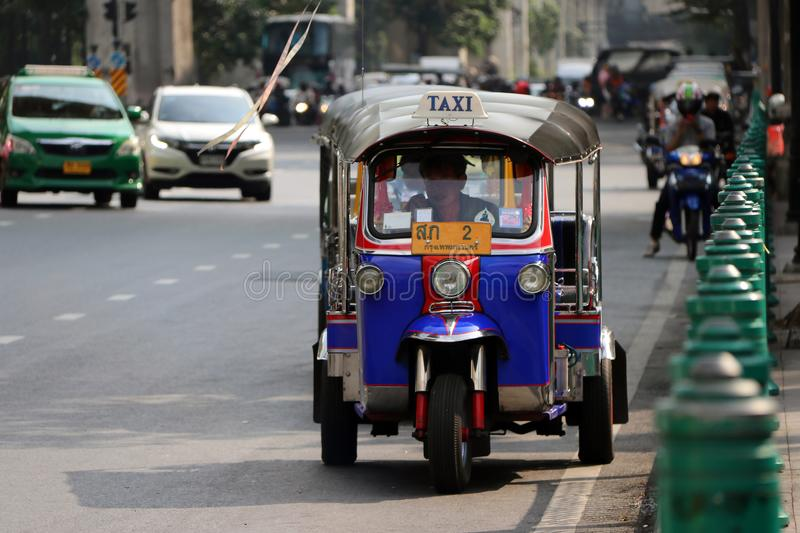 Tuk Tuk is a three-wheeled motorized vehicle used as a taxi are waiting and find for passengers on the road. stock photo