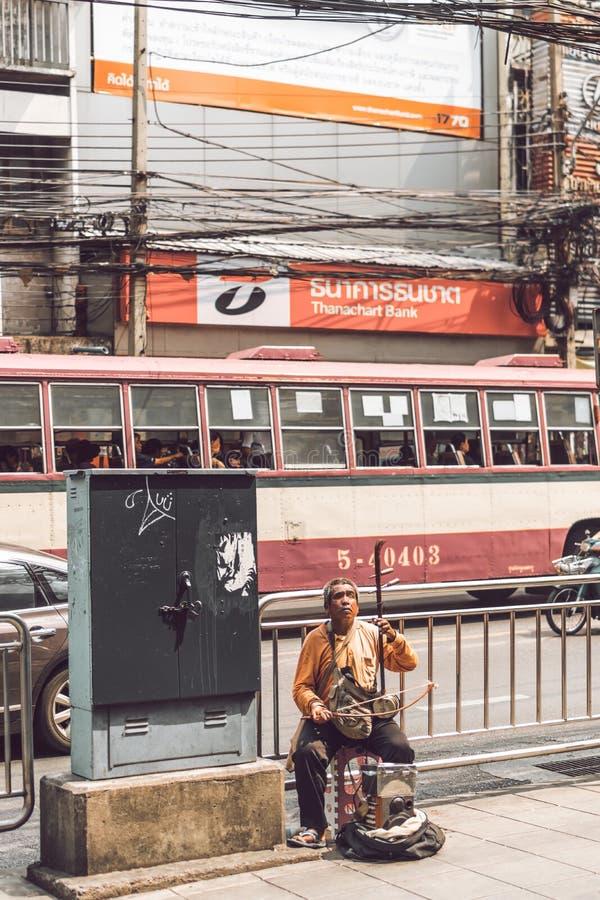 BANGKOK, THAILAND - FEBRUARY 2, 2018: Blind musician on the street of Bangkok city. stock photo