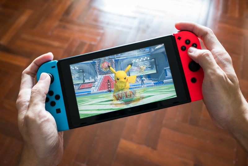 Pokken Tournament DX game on Nintendo Switch. Bangkok, Thailand - February 10, 2018 : Nintendo Switch showing its screen with Pokken Tournament DX, the Pokemon stock photos