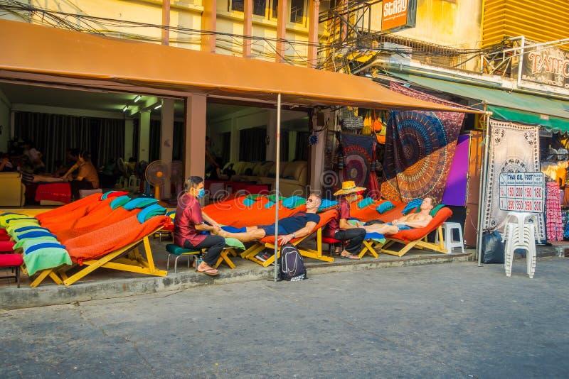 BANGKOK, THAILAND, FEBRUARY 08, 2018: Outdoor view of foot massage service in spa salon at Khao San Road market, Bangkok stock photo