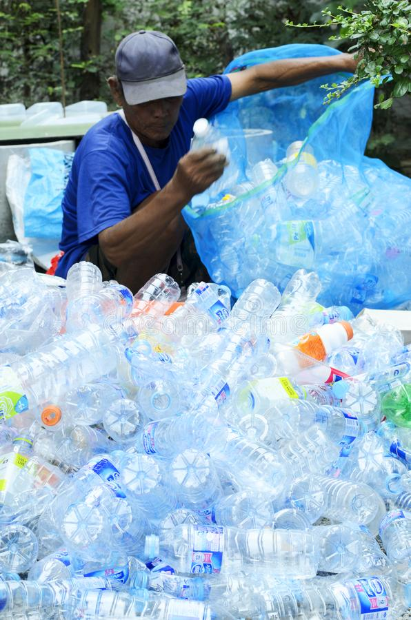 BANGKOK, THAILAND - February 27 : Plastic waste bottle with a man keeping for sale royalty free stock images