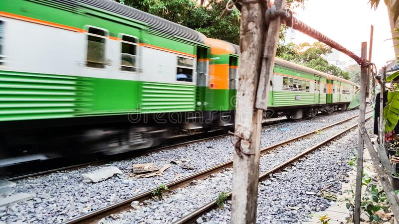 BANGKOK, THAILAND - FEBRUARY 15, 2018: The traditional Thai trains are sailing past the city center in the afternoon royalty free stock photos