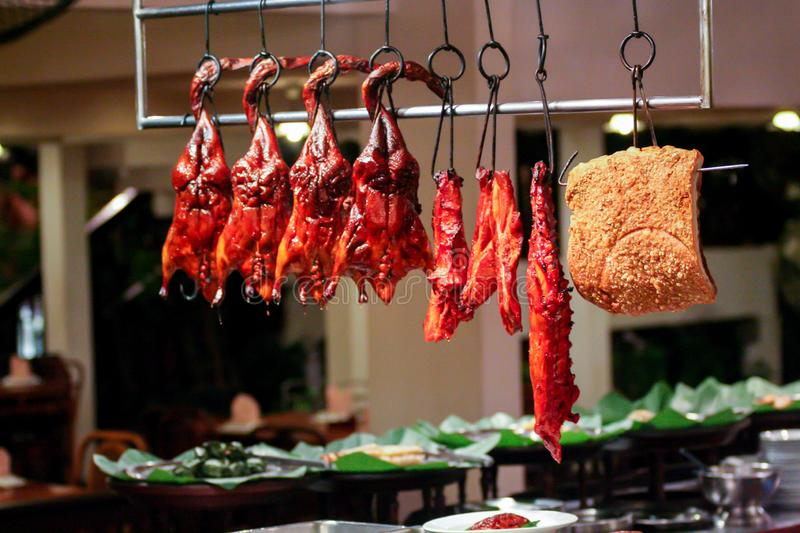 Fried ducks and another meat in cafe. Street food tonight. National kitchen of Asia. stock photos