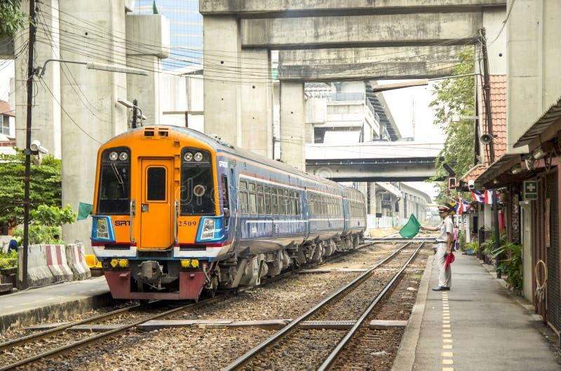 Master Station is waving green flag to make signaling for Make train depart leave. BANGKOK, THAILAND - 27 Jan 2018 : Master is waving green flag to make royalty free stock image