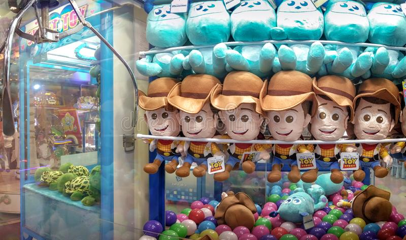 BANGKOK, THAILAND - JANUARY 14: Claw catcher in The Mall Bangkhae displays Disney licensed Sheriff Woody, from Toy Story and Jame. S P. Sullivan, from Monsters stock image