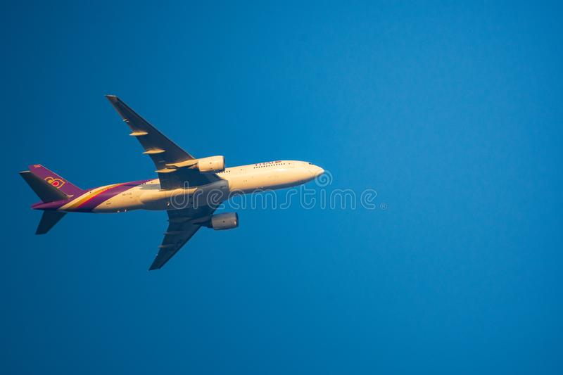 Closeup Thai Airways International Airline plane. Boeing 777-2D7ER taking off from Suvarnabhumi Airport with clear blue sky. BANGKOK, THAILAND : January 26 stock images
