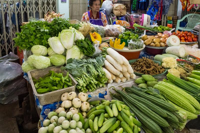 Bangkok, Thailand - January 27, 2018: Organic green vegetables sold on Maeklong railroad track market (Train Market) royalty free stock photos
