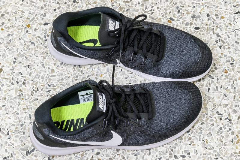 Bangkok, Thailand - January 16, 2018: View of nike shoes for running which are on the concrete floor. That is seem ready to run or. Jogging outside home with stock image