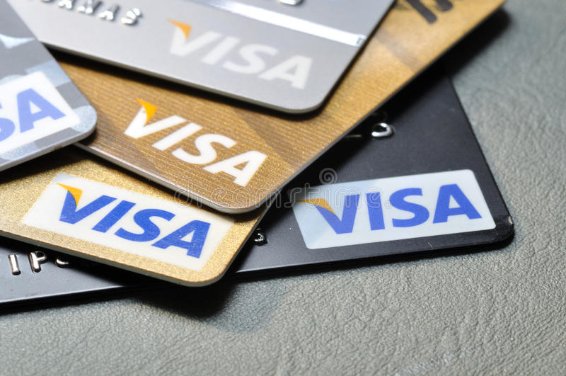 BANGKOK,THAILAND - January 28,2015: Visa credit cards on leathe. R board stock photos