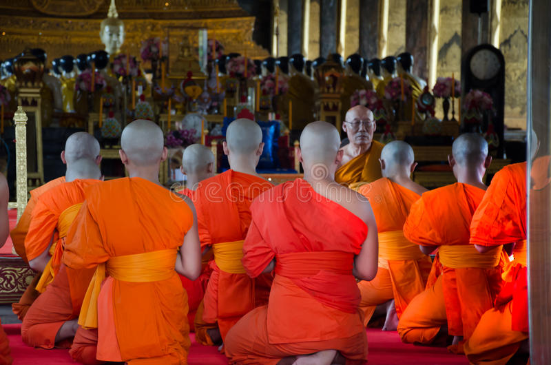 BANGKOK, THAILAND -11 JUL 2014 thai monks sit in the hall for th stock photos