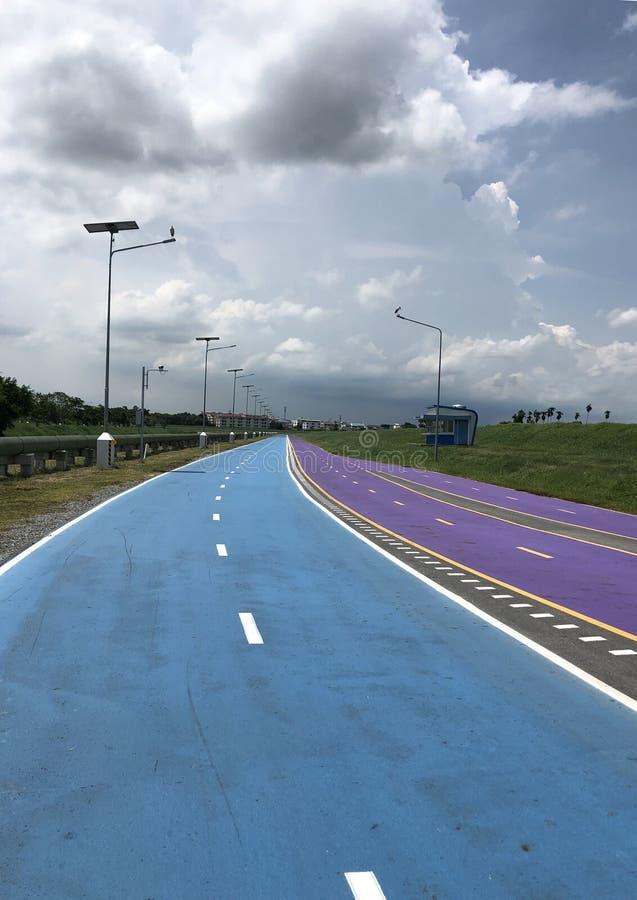 Bangkok, Thailand, the blue Skylane cycling path near the airport royalty free stock image
