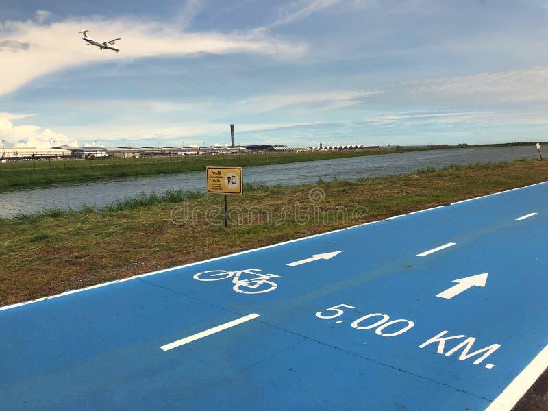 Bangkok, Thailand, the blue Skylane cycling path near the airport stock images
