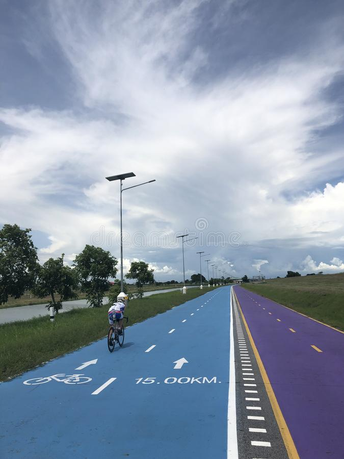 Bangkok, Thailand, the blue Skylane cycling path near the airport stock image