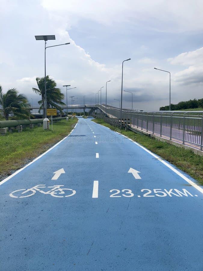 Bangkok, Thailand, the blue Skylane cycling path near the airport royalty free stock images