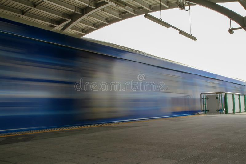 Bangkok,thailand-July 25,2015:The Bts train pass many fast at bts station,motion train move stock photos