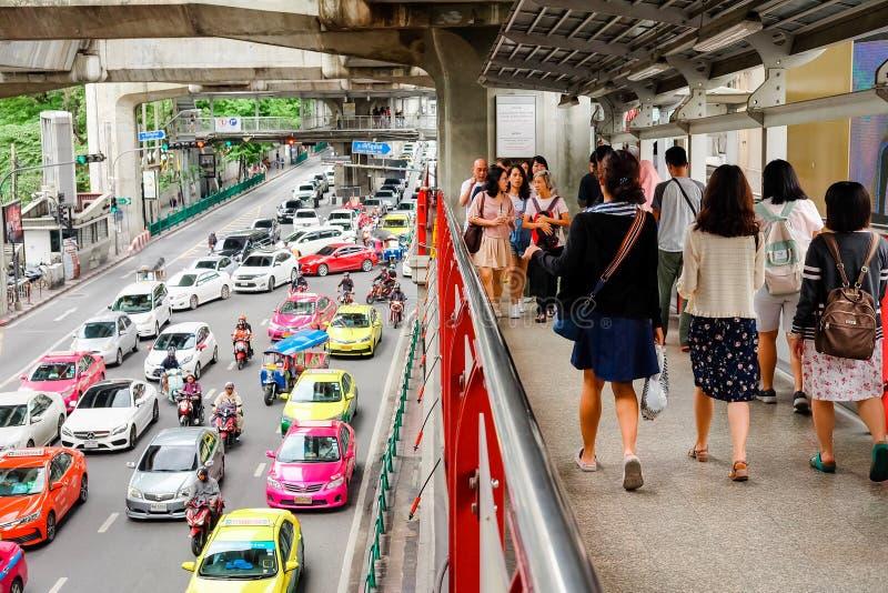 Bangkok, Thailand - July 07 2019: Cars cause traffic jams at Rama I Road. BTS at Siam Station. People walk on skywalk. Bangkok, Thailand - July 07 2019: Many car stock photos
