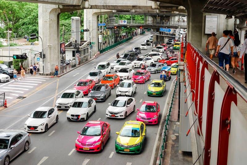 Bangkok, Thailand - July 07 2019: Many car cause traffic jams at Rama I Road. Under Bangkok skytrain BTS. People walk on skywalk. Bangkok, Thailand - July 07 stock images