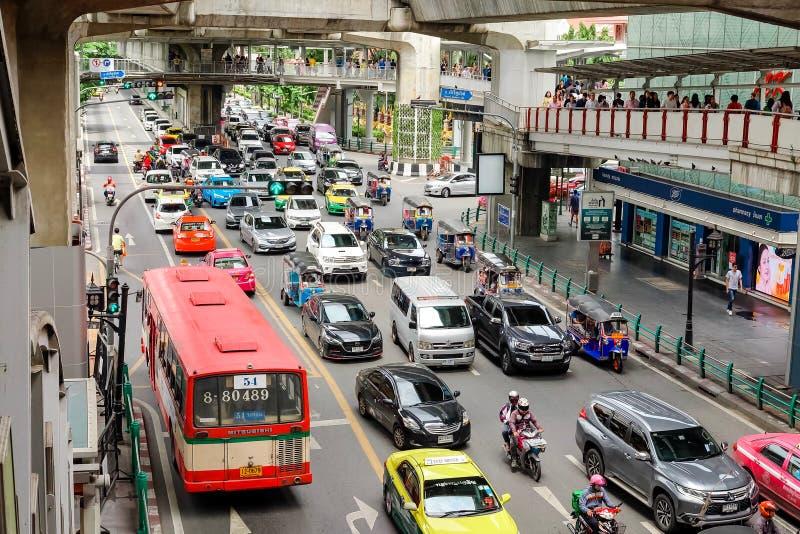 Bangkok, Thailand - July 07 2019: Many car cause traffic jams at Rama I Road. Under Bangkok skytrain BTS at Siam Station. Bangkok, Thailand - July 07 2019: Many royalty free stock photography