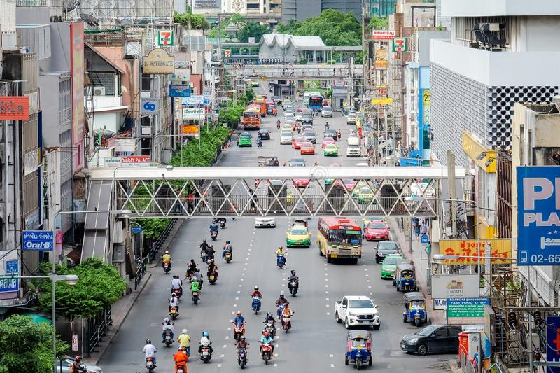 Bangkok, Thailand - July 21 2019: Many car cause traffic jams at Ratchaprarop Road have overpass. Many people walking on Sky Walk royalty free stock photos