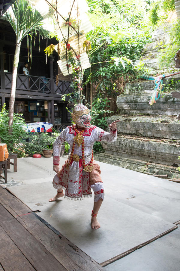 Bangkok, THAILAND - July 14, 2017: Puppet of Hanuman in Ramakien or Ramayana Story with Puppeteer wear the black mask in klong ba. Ng luang floating market in royalty free stock photo
