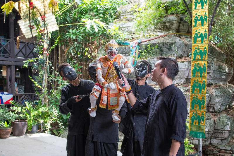 Bangkok, THAILAND - July 14, 2017: Puppet of Hanuman in Ramakien or Ramayana Story with Puppeteer wear the black mask in klong ba. Ng luang floating market in royalty free stock image