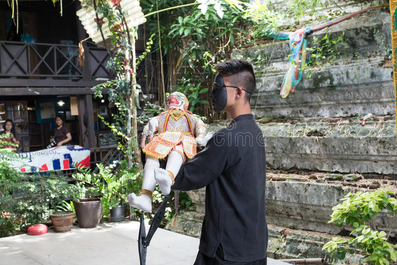 Bangkok, THAILAND - July 14, 2017: Puppet of Hanuman in Ramakien or Ramayana Story with Puppeteer wear the black mask in klong ba. Ng luang floating market in stock photos