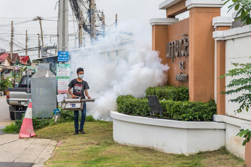 Fogging DDT spray mosquito kill for virus protect. Bangkok, Thailand - July 3, 2016 : Unidentified people fogging DDT spray for mosquito kill and protect by royalty free stock photos