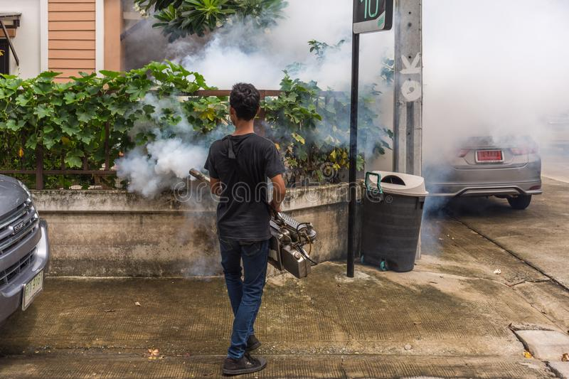 Fogging DDT spray mosquito kill for virus protect. Bangkok, Thailand - July 3, 2016 : Unidentified people fogging DDT spray for mosquito kill and protect by stock photos