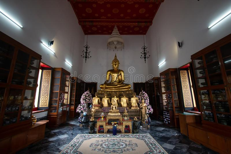 Bangkok, Thailand - July 9, 2018: Wat Pho or Wat Phra Chetuphon buddhist temple . golden buddha statue sitting . old historic beli stock photography