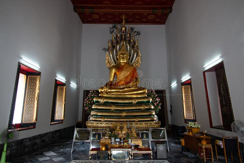 Bangkok, Thailand - July 9, 2018: Wat Pho or Wat Phra Chetuphon buddhist temple . golden buddha statue sitting . old historic beli stock photos