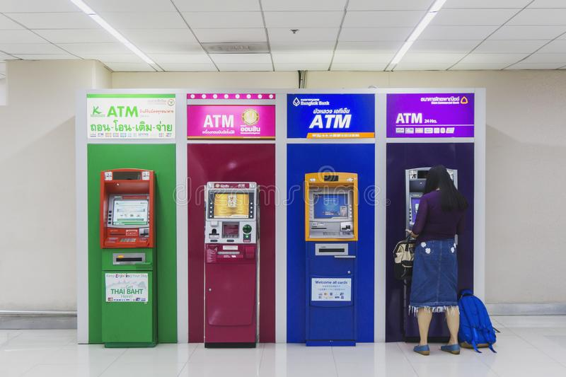 BANGKOK,THAILAND- JUNE 3 3019:Business woman using ATM machine to withdrawing money from credit card at ATM/bank machine keypad at royalty free stock images