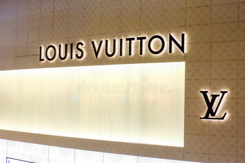 Bangkok, Thailand - June 02 2019: LOUIS VUITTION or LV logo on brand of Retail store at EMPORIUM. Night time royalty free stock image