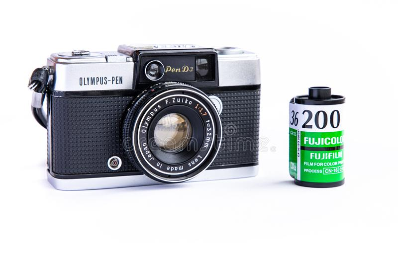 Olympus pen d3 vintage film camera with 35mm film cartridge isolated on white background. BANGKOK, THAILAND - June 29, 2019 : Olympus pen d3 vintage film camera royalty free stock images
