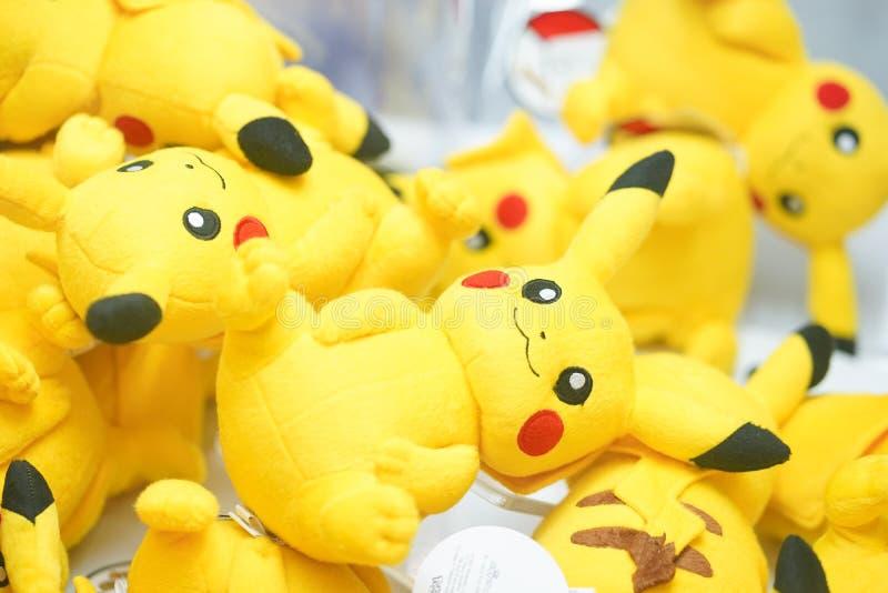 Doll catching machine interior view with Pikachu soft plush dolls inside stock photo