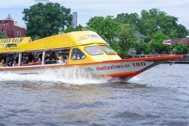 BANGKOK, THAILAND - JUNE 29: Public ferry number 180 speeds along Chaophraya river with passengers in Bangkok on June 29, 2019.  stock images