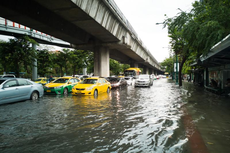 Bangkok, THAILAND - June 7, 2019: Traffic jam with flooding on Phahon Yothin Road near BTS Chatuchak station. Problem of transport stock image
