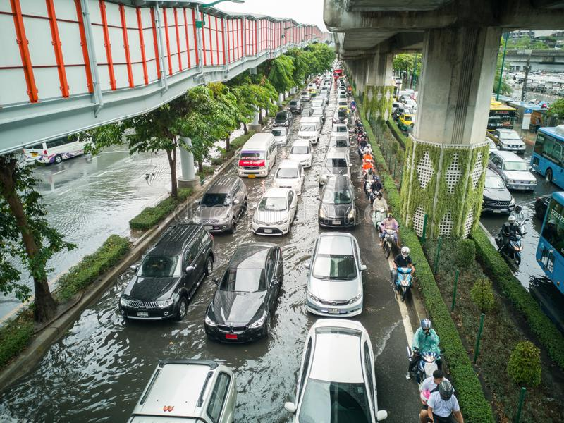 Bangkok, THAILAND - June 7, 2019: Traffic jam with flooding on Phahon Yothin Road near BTS Chatuchak station. Problem of transport royalty free stock photo
