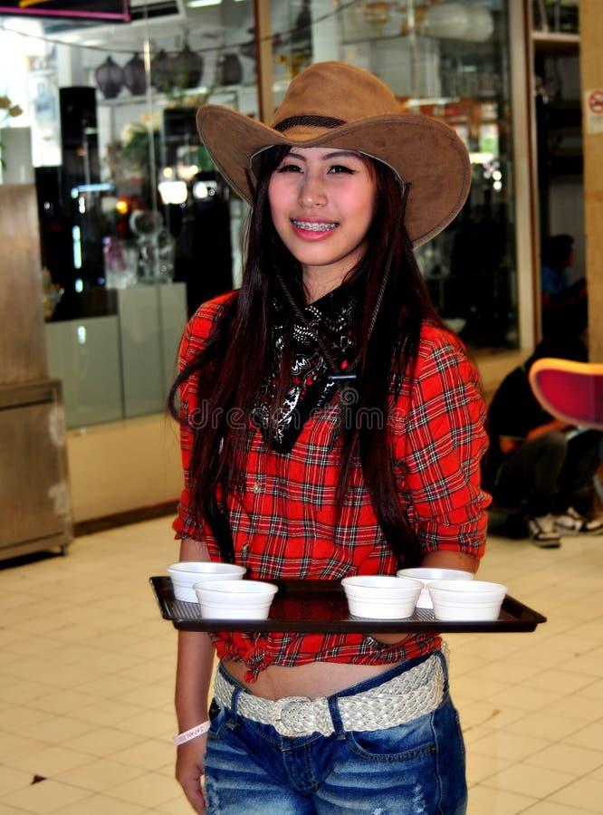 Bangkok, Thailand: Mädchen-tragender Cowboyhut lizenzfreie stockfotos