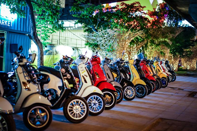 Bangkok, THAILAND - 6 Mar, 2016: In the Night of Rama9 road footpath - Vespa gang were parking in the line for meeting and stock photo