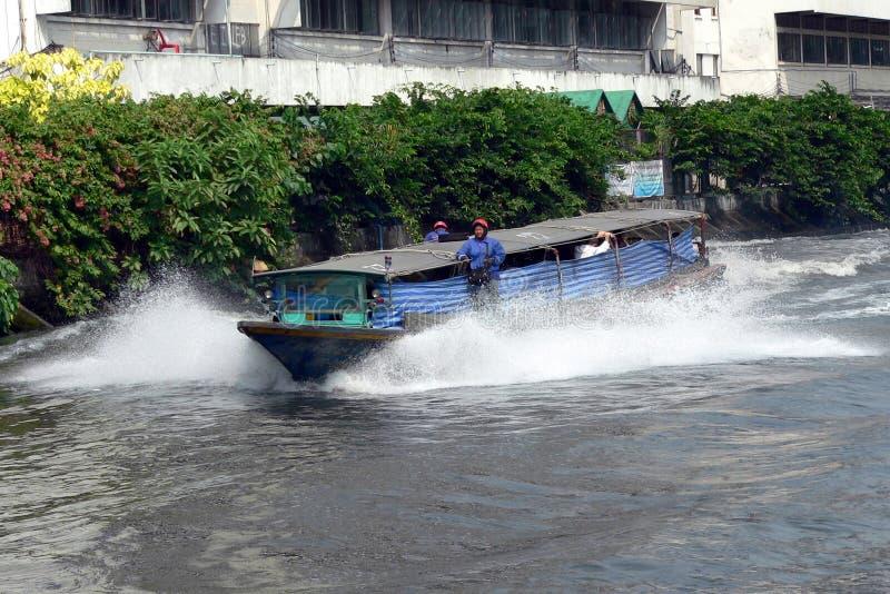 BANGKOK, THAILAND- MAR 1ST: A River Taxi Speeding Along The San Editorial Photo