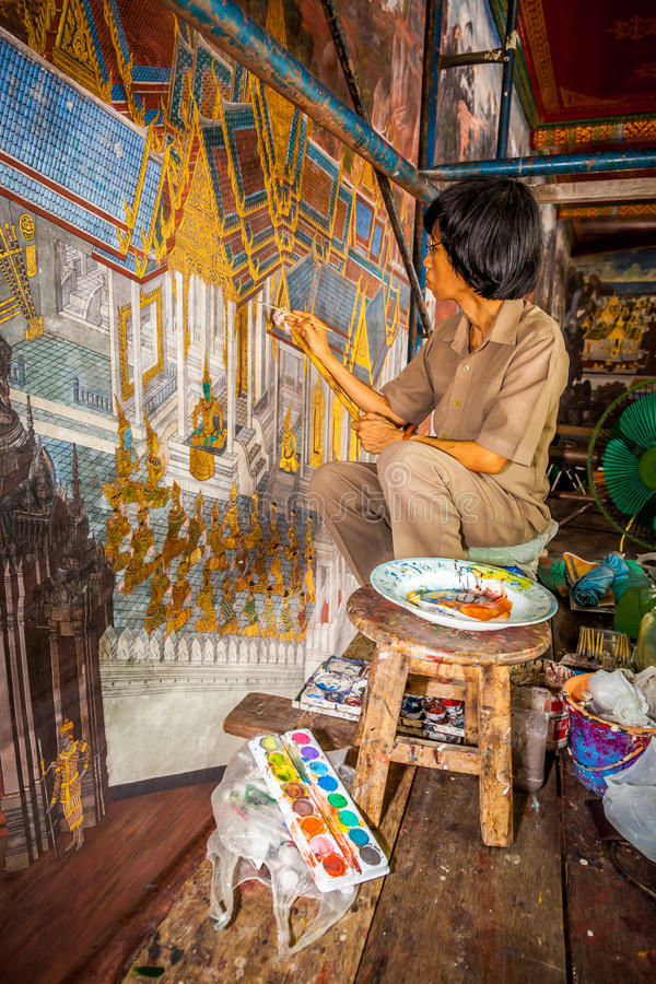 BANGKOK,THAILAND-MARCH 29: The artist painter is painting and repairing the ancient mural paint which over 200 years at Wat royalty free stock photo