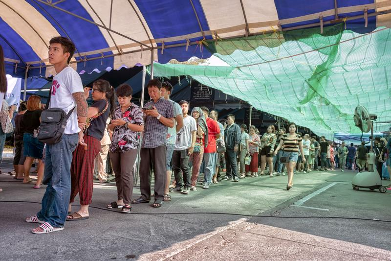 BANGKOK, THAILAND - MARCH 17: Citizens of Thailand from province line up in a long queue in the sun for election in Nongkhaem City royalty free stock image