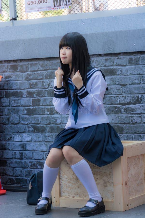 Cute Thai cosplayer dresses as Japanese schoolgirl posing royalty free stock photo
