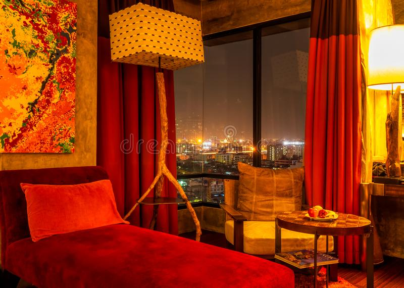 Bangkok, Thailand, March 2013 Luxurious penthouse, wall arts and designer interior, view on night cityscape stock photography