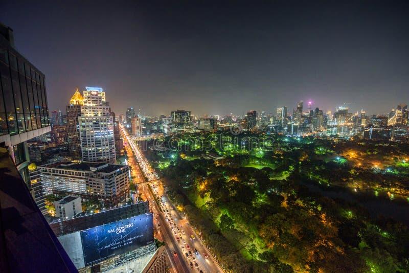 Night skyline of midtown Bangkok with Lumphini Park. Bangkok, Thailand - March 30, 2018 : Night skyline of midtown Bangkok with Lumphini Park and a traffic jam royalty free stock image