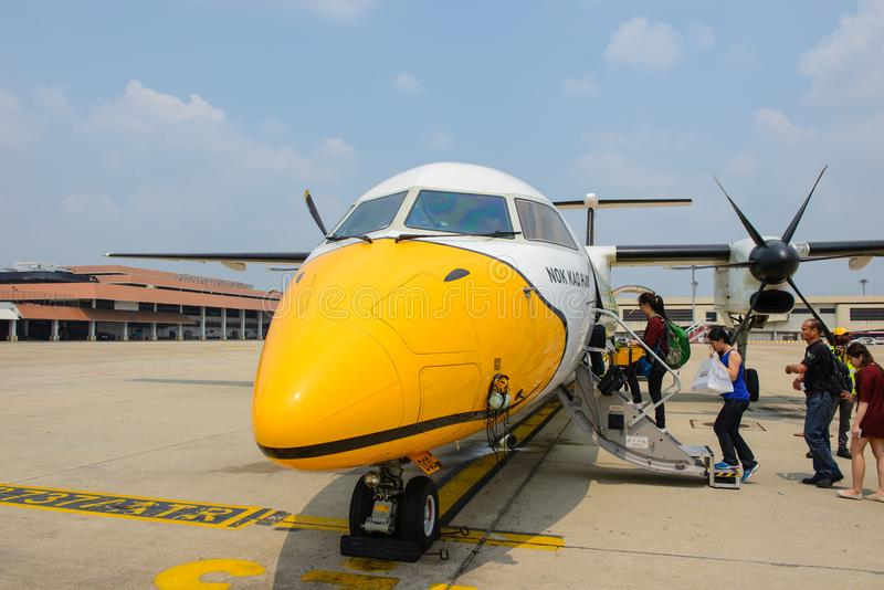 Bangkok, Thailand - March 13, 2015 : The Q400 nextgen of Nok Air flight DD8004 boarding passenger to Phrae at Don Mueang Airport,. Bangkok royalty free stock photography